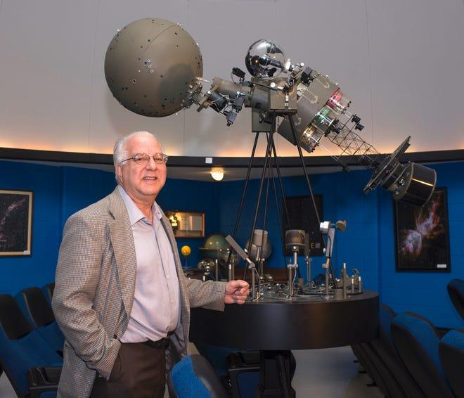 Mark Fairclough, the director of Adrian College's Robinson Planetarium, stands inside the planetarium.
