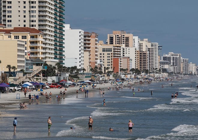 Beachgoers enjoy the surf and sun near the Dunlawton Avenue approach in Daytona Beach Shores on Sunday, Sept. 26, 2021. Forecasters with the National Weather Service in Melbourne said slightly cooler temps and sunny days are expected this week in Volusia/Flagler areas.