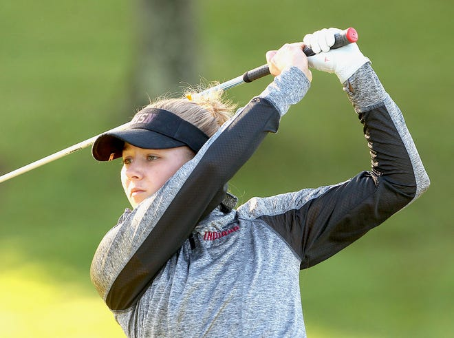 Bloomington North golfer Darian Laferty hits from the 10th tee at Country Oaks Golf Course Saturday.