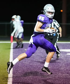 Bloomington South's Tysen Smith (85) scores a touchdown during the game against Southport at South Friday evening.