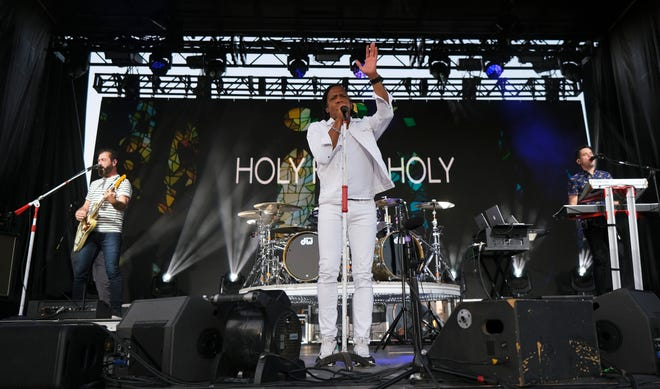 """Newsboy lead singer Michael Tait lifts up the crowd in song. Evangelist Franklin Graham's """"Route 66: God Loves You"""" tour on the south lawn of the Capitol in Oklahoma City Saturday night, September 25, 2021."""