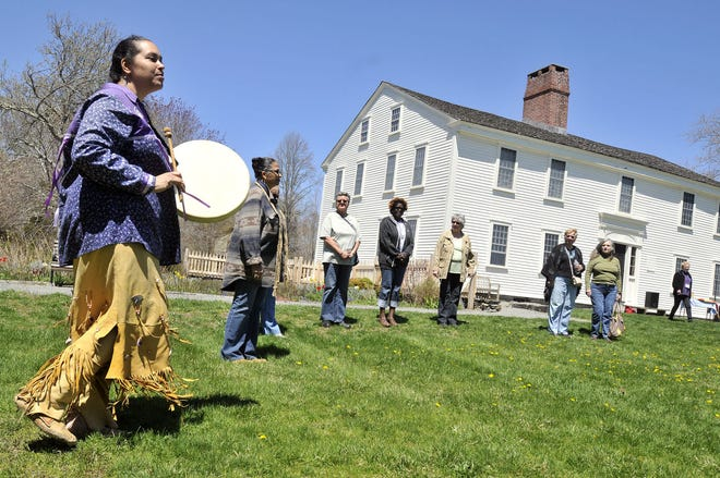 """Loren Spears, left, executive director of the Tomaquag Museum in Exeter, leads a welcome dance during the 2018 """"Heritage Days: Indigenous Peoples"""" event at Smith's Castle in North Kingstown."""