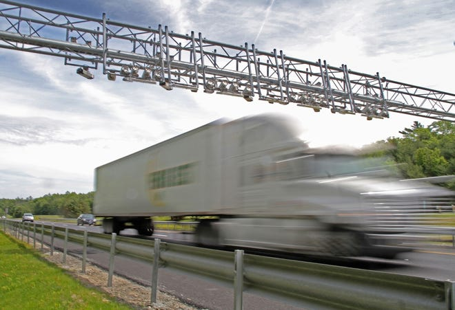 A truck passes one of two tolling gantries on Route 95 in South County. More than three years after it began, the trucking industry's legal challenge to the system of electronic eyes charging big rigs on the highway is still going through the courts.