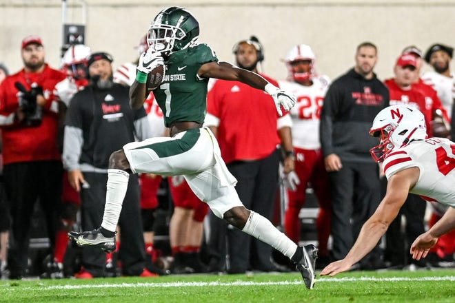 Michigan State's Jayden Reed returns a punt for a touchdown against Nebraska during the fourth quarter on Saturday, Sept. 25, 2021, at Spartan Stadium in East Lansing.  210925 Msu Nebraska 227a