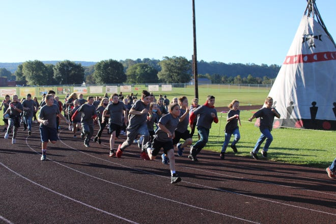 The Meyersdale Area Elementary School kicked off its 4th annual Walk-a Thon Sept. 24, under blue skies and with lots of enthusiasm. Students in kindergarten through fifth grade sought sponsors for their efforts, as well as flat donations. Students in kindergarten and first grade had 30 minutes to walk/run as many half-laps as possible. Students in second through fifth grade will have one hour to complete as many full laps as they are capable.  Pledge forms and donations are due at the school by Oct. 8. Proceeds will benefit student activities and field trips. Sponsored by the Meyersdale Area Elementary Educational Boosters, this annual event has raised more than $50,000 in the past four years.