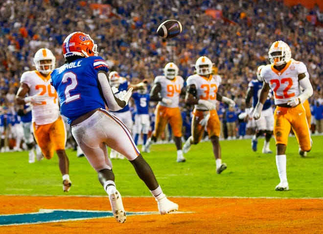 Florida tight end Kemore Gamble (2) hauls in a touchdown pass from wide receiver Trent Whittemore off a trick play in the second half Saturday against Tennessee to make it 24-14 at Ben Hill Griffin Stadium.