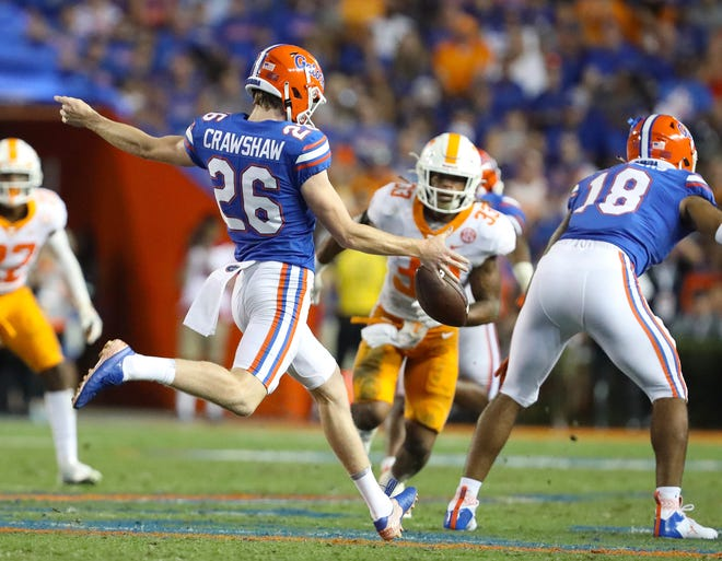 Jeremy Crawshaw (26) is in his first season punting for Florida.