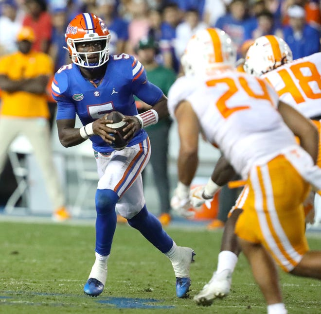 Florida quarterback Emory Jones (5) looks to throw the ball Saturday against Tennessee at Ben Hill Griffin Stadium.