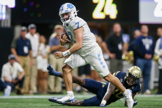 North Carolina Tar Heels quarterback runs for a touchdown against the Georgia Tech Yellow Jackets in the first quarter Saturday night at Mercedes-Benz Stadium.
