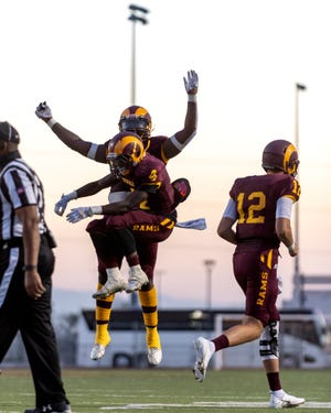 Victor Valley College's Kenyard Edwards Jr. celebrates after scoring one of his three first-half touchdowns against Pierce College in Adelanto on Sept. 24, 2021.