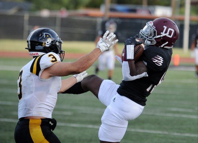 La'Darius Rucker recovers an onside kick in the fourth quarter of Saturday's game between McMurry and Southwestern.