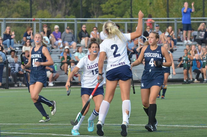 Eastern seniors Izzy Bianco and Ryleigh Heck celebrate Heck's goal in the first quarter against Episcopal Academy  (Pa.) at the Max Field Hockey National Invitational