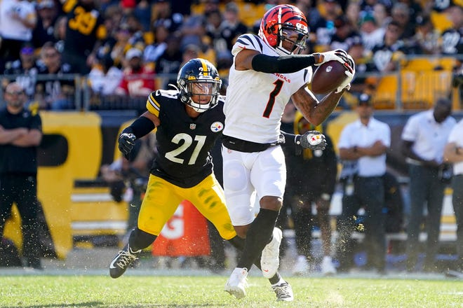 Cincinnati Bengals wide receiver Ja'Marr Chase (1) catches a pass as Pittsburgh Steelers cornerback Tre Norwood (21) defends in the fourth quarter during a Week 3 NFL football game, Sunday, Sept. 26, 2021, at Heinz Field in Pittsburgh.