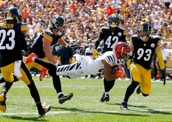 Tyler Boyd #83 of the Cincinnati Bengals scores a touchdown during the first quarter in the game against the Pittsburgh Steelers at Heinz Field on September 26, 2021 in Pittsburgh, Pennsylvania.