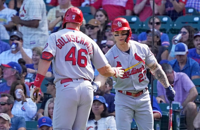 St. Louis Cardinals first baseman Paul Goldschmidt (46) is greeted by left fielder Tyler O'Neill (27) after hitting a home run against the Chicago Cubs during the third inning at Wrigley Field on Sept. 26.