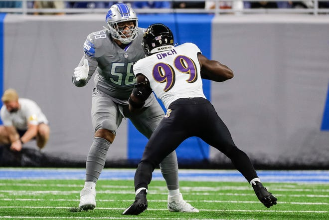Detroit Lions offensive tackle Penei Sewell blocks Baltimore Ravens linebacker Odafe Oweh in the first half at Ford Field in Detroit on Sunday, September 26, 2021.