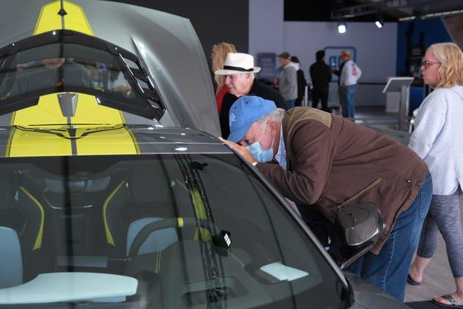 Dan Aldrich, 72, admires the inside of the 2022 Chevrolet Corvette at Motor Belle on Sunday, Sept. 26.