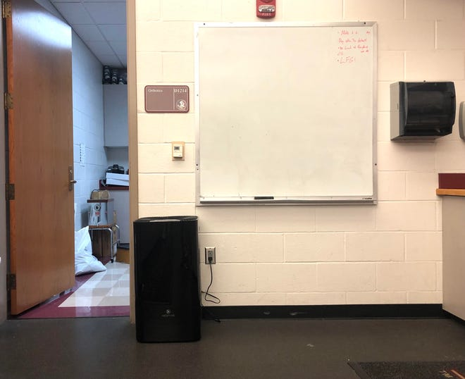 One of the new air purifiers in the FSU football training room.