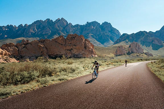 Bicyclists ride near Dripping Springs Natural Area in Doña Ana County.