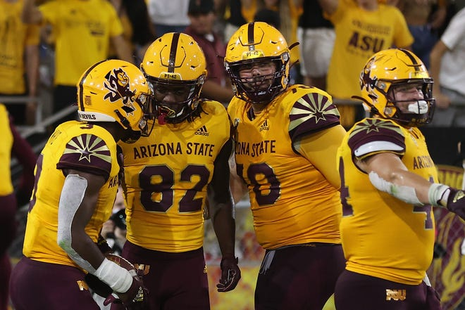 TEMPE, ARIZONA - SEPTEMBER 25: Running back Rachaad White #3 of the Arizona State Sun Devils celebrates with Andre Johnson #82 and Henry Hattis #70 after White scored on a 30-yard touchdown reception against the Colorado Buffaloes during the second half of the NCAAF game at Sun Devil Stadium on September 25, 2021 in Tempe, Arizona.
