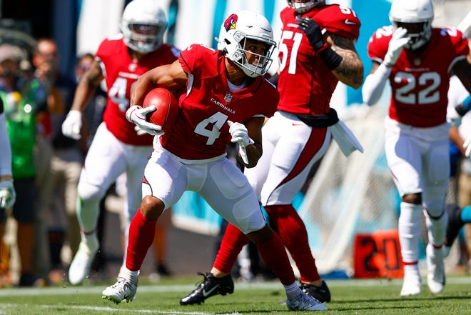 Sep 26, 2021; Jacksonville, Florida, USA;  Arizona Cardinals wide receiver Rondale Moore (4) runs with the ball in the first quarter against the Jacksonville Jaguars at TIAA Bank Field. Mandatory Credit: Nathan Ray Seebeck-USA TODAY Sports