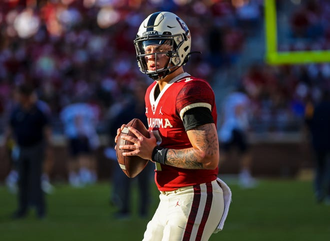 Sep 25, 2021; Norman, Oklahoma, USA; Oklahoma Sooners quarterback Spencer Rattler (7) throws before the game  against the West Virginia Mountaineers at Gaylord Family-Oklahoma Memorial Stadium. Mandatory Credit: Kevin Jairaj-USA TODAY Sports