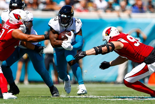 Sep 26, 2021; Jacksonville, Florida, USA;  Jacksonville Jaguars running back Carlos Hyde (24) runs with the ball in the first quarter against the Arizona Cardinals at TIAA Bank Field. Mandatory Credit: Nathan Ray Seebeck-USA TODAY Sports