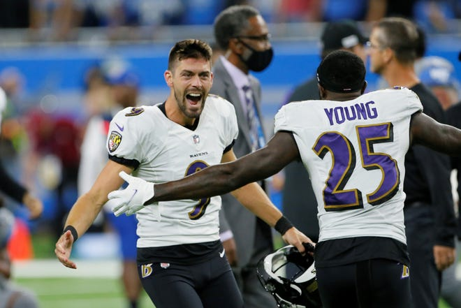 Baltimore Ravens kicker Justin Tucker (9) celebrates with Tavon Young (25) after kicking a 66-yard field goal in the second half of an NFL football game against the Detroit Lions in Detroit, Sunday, Sept. 26, 2021. Baltimore won 19-17. (AP Photo/Duane Burleson)