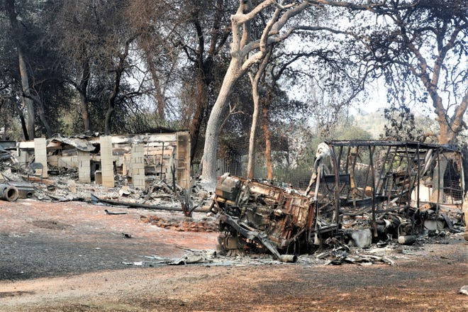 A building destroyed by the Fawn Fire sits off Sunrise Drive northeast of Redding on Friday, Sept. 24, 2021.