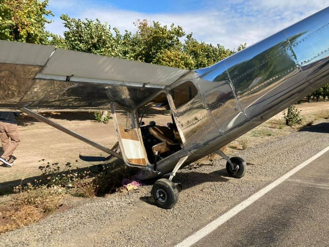 Occupants of a small plane were uninjured after crash-landing on a road in a field east of Salem near the Willamette Valley Pie Company on Sunday.