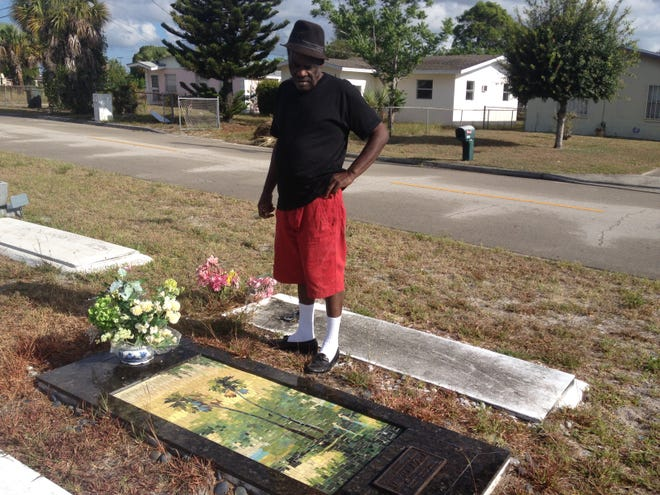 Highwaymen artist Willie Daniels, who died Sept. 19, 2021, visits the grave of his  his brother Johnny Daniels in 2015. Willie Daniels and Johnny Daniels mentored, supported, and accredited Florida Highwaymen Artist as a 2nd Generation