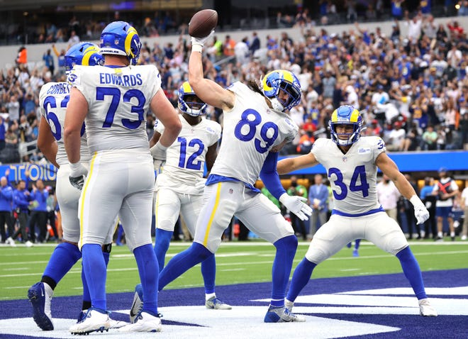 Tyler Higbee #89 of the Los Angeles Rams spikes the ball after scoring a touchdown during the second quarter in the game against the Tampa Bay Buccaneers at SoFi Stadium on September 26, 2021 in Inglewood, California.