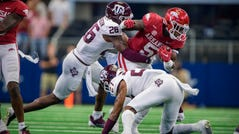 Arkansas running back Raheim Sanders (5) is tackled by Texas A&M defensive back Demani Richardson (26) during the second quarter at AT&T Stadium.