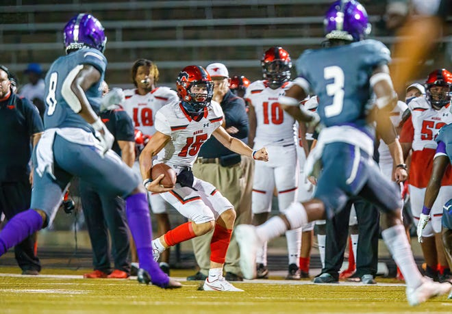 Manor quarterback Jayson Zardavets, scrambling for yardage in the season-opener against LBJ, helped his team beat Leander on a last-second field goal in the District 11-5A DI opener Friday.