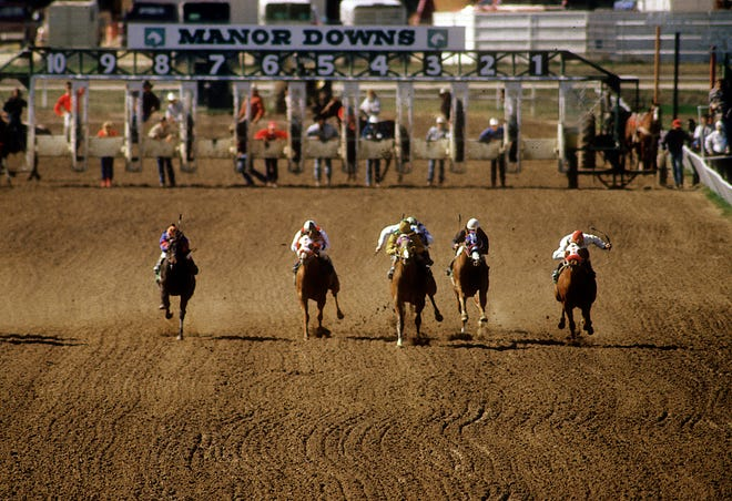 Horses race at Manor Downs in 1987 in the file photo. A developer plans an industrial park on the site of the former horse racing track.