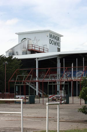 A file photo shows Manor Downs shortly after it closed in 2010. A developer plans an industrial park on the site of the former horse racing track.