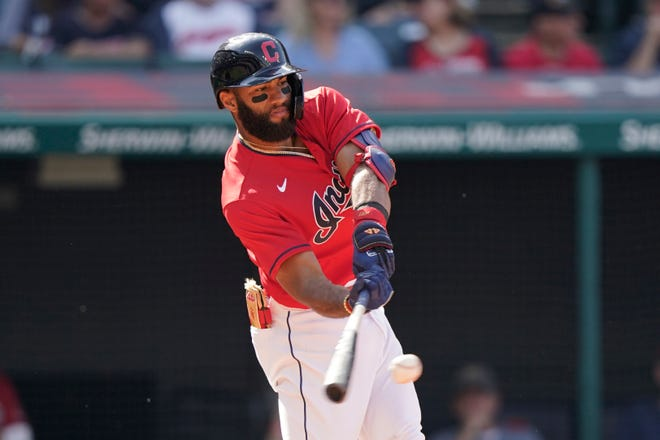 Cleveland's Amed Rosario hits an RBI-single in the sixth inning of a baseball game against the Kansas City Royals, Monday, Sept. 27, 2021, in Cleveland. (AP Photo/Tony Dejak)