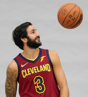 Cleveland Cavaliers guard Ricky Rubio tosses a ball around during Cavs Media Day at Cleveland Clinic Courts, Monday, Sept. 27, 2021, in Independence, Ohio.