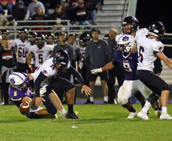 Nevada's Ty Dittmer forces a fumble as he sacks Gilbert quarterback Owen Kautman during the No. 5 Cubs' 56-14 homecoming victory over the Tigers in Class 3A District 2 play Friday at Cub Stadium in Nevada.