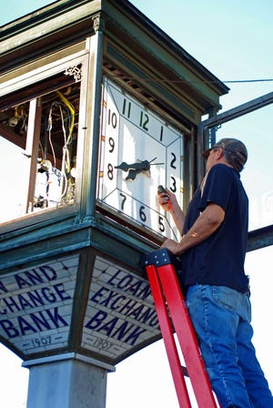 A craftsman with the Christopher Paccard Bell Foundry removes pieces of the historic Lee Avenue clock in Hampton last week.