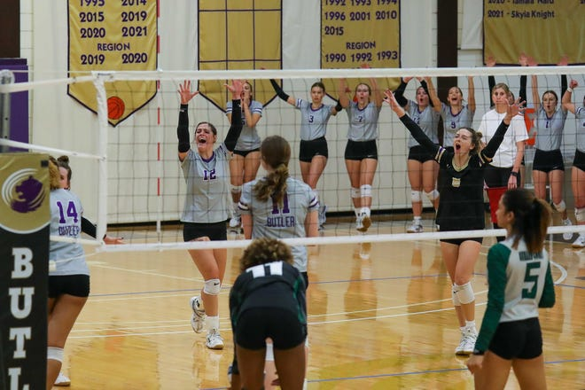 Butler volleyball celebrates a set point in their win over No. 10 Seward County on Saturday, Sept. 25.