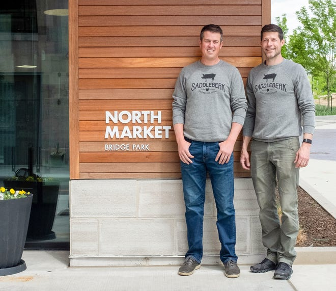 Dave Rigo, left, and Greg Lehman (founders of Watershed Distillery) are ready to launch Saddleberk's new butcher and grocer concept in North Market Bridge Park.