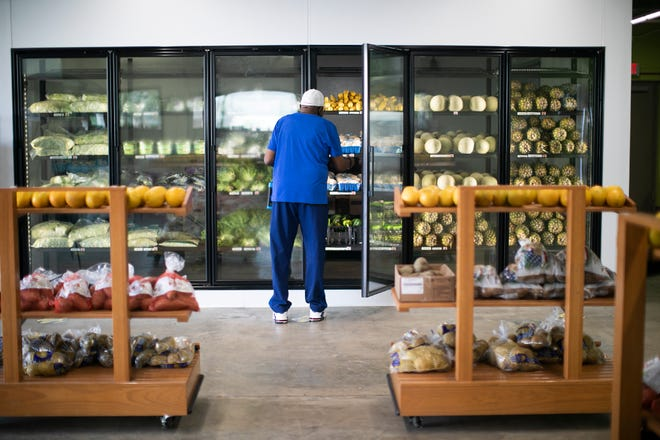 James Oliver Jr., 87, of North Columbus shops at the new Linden Fresh Market and Charitable Pharmacy.