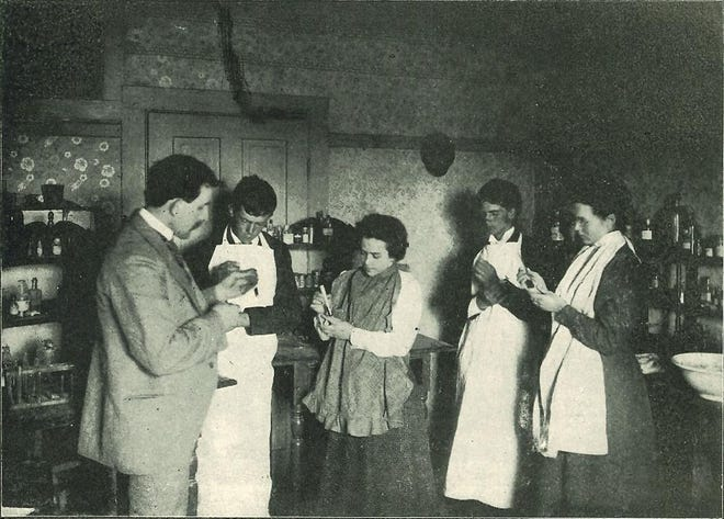 Students are pictured hard at work in the chemistry lab at Raisin Valley Seminary, around the year 1900. The science department was equipped with the latest in laboratory equipment.