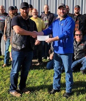 Lunacy MC donates to Lake Region Search and Rescue.