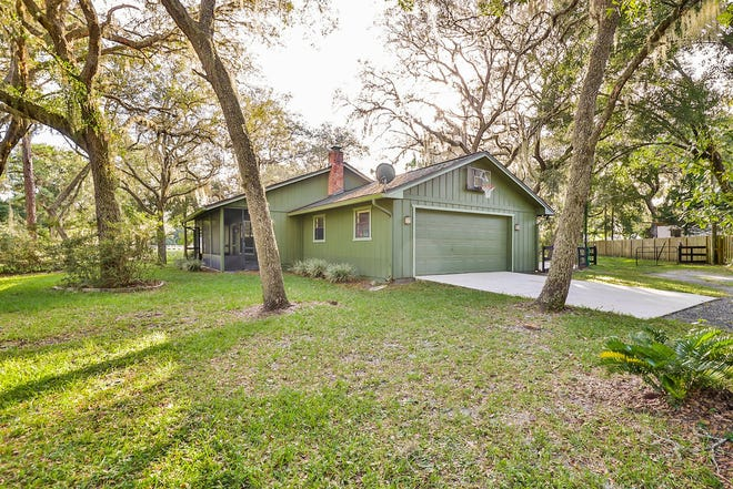 This lovely three-bedroom, two-bath pool home is nestled on over an acre at the end a street in Ormond Beach.