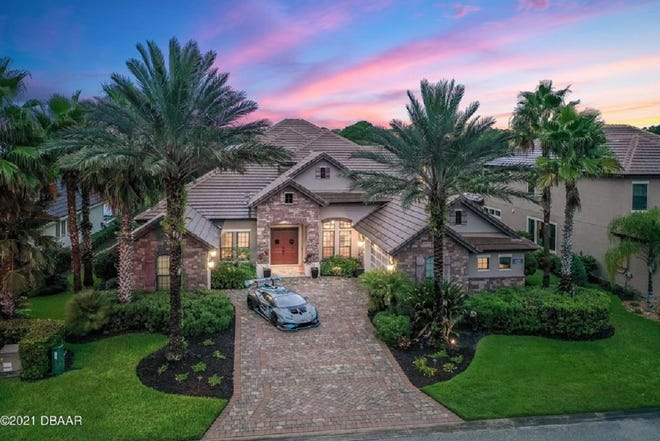 This award-winning showplace in Ormond Beach overlooks the eighth hole of one of Plantation Bay's golf courses.
