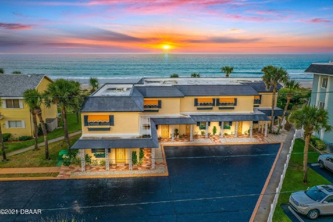 The gorgeous white, sandy, no-drive beach creates a gorgeous backdrop for this direct-oceanfront home that is part of a five-unit building in Ponce Inlet.