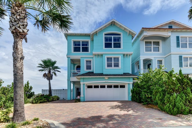 This oceanfront oasis, located above the sands of a no-drive beach in Ponce Inlet, is three stories of spectacular coastal living.