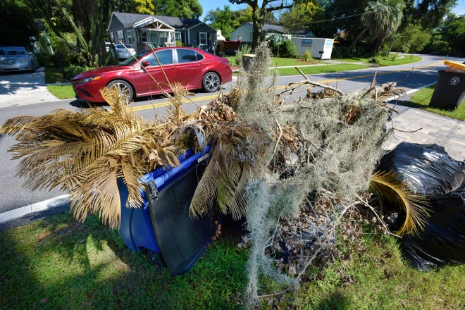 Yard waste is piled alongside Jacksonville's Lakeshore Boulevard, waiting for pickup, in this Sept. 23 photo. Staffing problems among the city's waste-hauling contractors led the city to suspend collection of recyclables, like those to the right in this photo, to focus on collection of trash and yard waste.